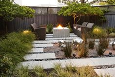 An Earthy Contemporary style garden is loose and livable yet still filled with straight lines and restrained details.