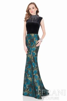 Sophisticated two piece ensemble of a rich Black velvet with stone necklace pairs to a vibrant tonal pattern skirt with a revealing slit.