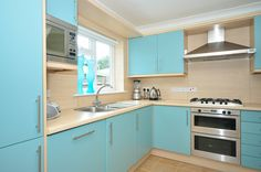 Pale blue units paired with the pale wood pannelling & counter top; lovely