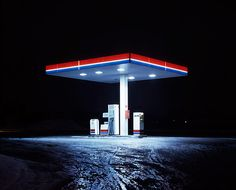 """Cold Stations"" - British photographer Matt Barnes has captured the loneliness that comes along with winter in his series of photographs titled Cold Station, which consists of images of gasoline stations at night during Winter. As haunting as the photos may seem, he still manages to show the beauty in isolation..."