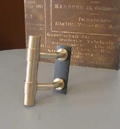 Individuelle Türgriffe aus Bronze für eine Haustüre