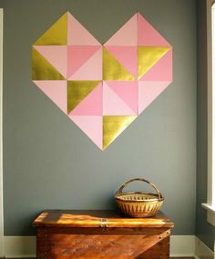 This giant DIY geometric wall art heart is a must-make for Valentine's Day decor.