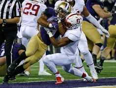 Washington running back Myles Gaskin, left, powers past Stanford safety Justin Reid, right, for a touchdown in the second half of an NCAA college football game, Friday, Sept. 30, 2016, in Seattle. (AP Photo/Ted S. Warren)