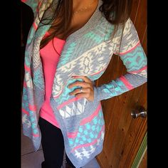 Love the sweater could wear with different color under shirts... Where can i get one??