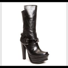Donald J. Pliner boot Impossible to find anywhere-I looked! Amazing black leather platform boot with chain detail. Model: DMSX Lauren. Never worn but has some very minor scratches on the heel. No box. Donald J. Pliner Shoes