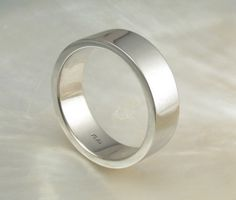 7mm wide mens platinum pipe / flat wedding band / wedding ring, hand forged. $2,088.00, via Etsy.