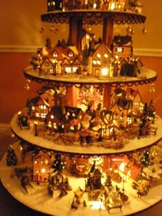 Christmas Village tree - light up!  That's kinda a cute idea - maybe for next year?