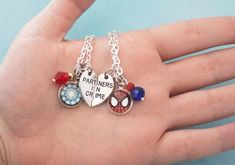 """If you love Tony Stark and his new """"adopted"""" son and/or protégé Peter Parker, you'll love this necklace set! Dedicated to Spider Man and Iron Man, this Marvel friendship necklace set is perfect for you and your best friend. Parker Tony, Marvel Clothes, Bff Necklaces, Iron Spider, Friendship Necklaces, Heart Charm, Crystal Beads, Necklace Set, Iron Man"""
