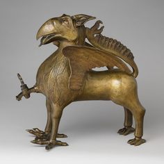 Aquamanile in the Form of a Griffin, ca. 1425–50  German (Nuremberg)  Copper alloy    12 9/16 x 4 11/16 (chest), 6 3/4 (claws) x 6 1/2 (wings) x 11 5/8 (with spout 12 11/16) in. (31.9 x 11.9 [chest], 17.2 [claws], 16.5 [wings] x 29.5 [with spout 32.3] cm)  Robert Lehman Collection, 1975 (1975.1.1413)