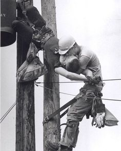 The Kiss of Life by Rocco Morabito. Pulitzer Prize for Photography, Power lineman J. Thompson performs mouth-to-mouth resuscitation on Randall Champion at the top of a utility pole where Champion brushed one of the high voltage lines.
