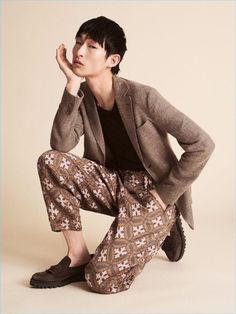 Starring in an editorial for Sleek magazine, Sang Woo Kim wears Giorgio Armani.