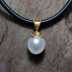Gold and Pearl Pendant on rubber cord – Unio Goldsmith Pearl Pendant, Diamond Pendant, Pendant Necklace, Pearl Jewelry, Pearl Earrings, Best Investments, Black Diamond, Cord, Gems