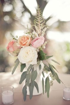 vintage milk pitchers, mason jars, mercury glass, lanterns, and antique wine glasses to show off their combinations of light pink peonies, hydrangeas, dusty miller, wax flowers, and astilbes.