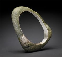 "Andrea Williams - ""Sa Bangle"" : Center cut from a single beach stone and lined with reclaimed fine silver."
