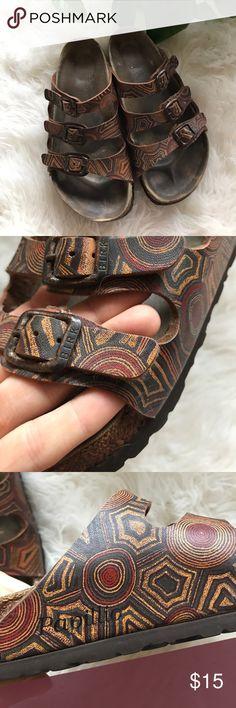 Birkenstocks Aztec sun print Birkenstock papillio aztec sun print sandals in fair used condition. Wear on heels shown in photos. Otherwise in decent shape. Sized US ladies 7 but run big. Run a bit wide. I'd say best for an 8-8.5 wide. Birkenstock Shoes Sandals