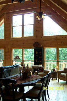 Log Cabin Great Room, Interior of our recently built log cabin., View of windows in great room, Living Rooms Design