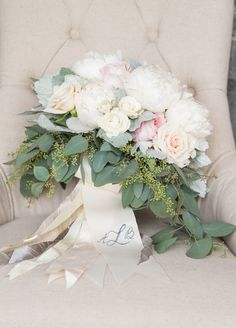 This dreamy bridal bouquet has a very soft feel, but the seeded eucalyptus adds a smaller scale and dynamic texture as the design transitions into more greenery (a great technique if you don't want a too-round bouquet).