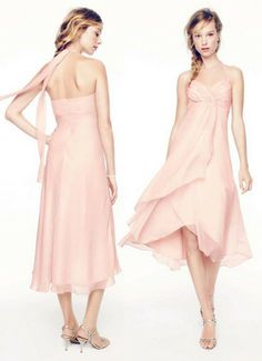 Exceptionally beautiful and ultra-feminine, this chic bridesmaid dress is perfect for any affair!  A halter bodice pairs well with an empire waist featuring dazzling beaded detail, while a high-low hemline is perfect for either a formal or casual wedding. Pictured in Petal, but available in all David's Bridal colors.