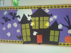 Halloween Board. The students made the ghosts using their hands and white paint.