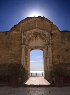Magical view through the doorway of a ruined church in Vasto, Italy