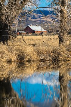 Nice day reflection - A nice day at the Whitman Mission near Walla Walla, WA. The Blue Mountains of SE Washington/NE Oregon are in the distance behind the little red barn.