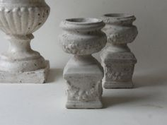 two cement urns by unpotpourri on Etsy