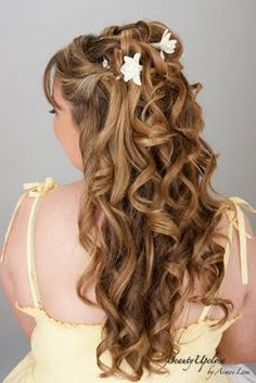 Half up tumbling curls, with a few hair jewels and silk flowers