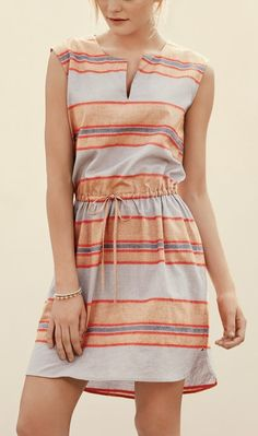 This adorable sleeveless dress projects an easygoing air in stripe-patterned linen with a drawstring-cinched waist and shirttail-style curved hem.