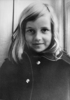 Posing for a portrait in a peacoat as a child.   - HouseBeautiful.com