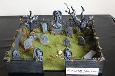 A dollhouse miniature graveyard scene set on a MDF board, 40 x 40 cm.   I have uploaded a short video on YouTube which can be viewed by