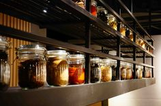Jars of spices line the walls of this ramen shop located in Suntec City.