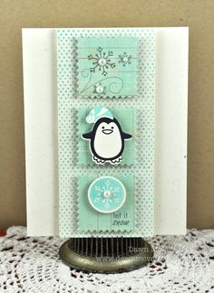 mint green and cream themed, trio of boxes with penguin in middle