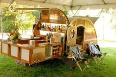 a bar with retro camper. too cool