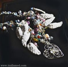 Sterling silver handmade filigree, handmade porcelain and handmade lampwork beads. Freshwater pearls, czech crystal beads.
