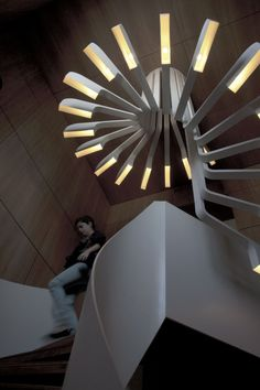 .PSLAB have created custom lighting for the spiral staircase in a home in Beirut, Lebanon.