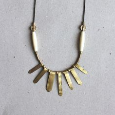 ASTRA necklace  Brass and vintage bone  by Tzunuum on Etsy, $90.00