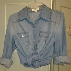 Iris Los Angeles light denim color shirt This Iris Los Angeles shirt has snap closures and looks like denim but feels soft like cotton! Can be worn with sleeves rolled up and front tied up, as shown in 1st pic...or can be worn as is. Great condition! No holes, stains, or tears. Size small but fits like a Medium. 2 breast pockets that function & snap closed.  10% off with 2+ bundle!!! Iris Los Angeles Tops Button Down Shirts