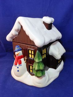 Ceramic SNOW COVERED CABIN COOKIE JAR Reminiscent of a Cartoon Scene Available at: ManicMerchandiseandCollectibles.com