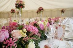 Top table arrangements and tall table centres in the background.