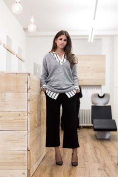 spring / summer - fall / winter - street style - chic street style - casual outfits - fashion week - fall outfits - business casual - work outfits - office wear - grey oversized v-neck sweater + black and white striped shirt + black culottes + black stilettos