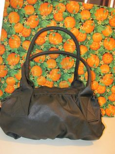 PAYLESS    WOMENS BLACK    VINYL/POLYESTER    SATCHEL HANDBAG    MINT CONDITION    FOR PREOWNED    10 IN HEIGHT    15 IN LENGTH    6 ¾ IN DEEP    9 IN STRAP DROP    VERY CLEAN    NO RIPS OR TEARS    SUPER CUTE    WONDERFUL ADDITION    TO YOUR WARDROBE