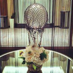 Mini hot air balloon centerpiece, Whimsical, white flowers.