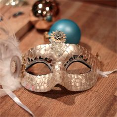 """Use simple Christmas ornaments to make awesome masquerade or party masks! """"Saw some really pretty masques at Pier 1 and this seems like cheap way of making some"""""""