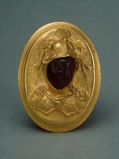 gold and ebony brooch
