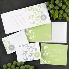 """Green and White Flowers.  This bright white, shimmering tea-length invitation card features a shimmery back pocket with a floral flourish design. The design cannot be changed or removed and is available in your choice of imprint color.   9 1/2"""" x 4 1/4"""""""