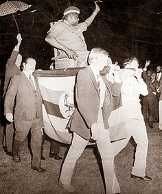 """Ugandan Dictator Idi Amin is Carried by British Businessmen. Amin Said """"We Africans Used To Carry Europeans,But Now They are carrying Us.We Are now the Masters...""""  1975."""