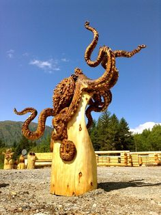 Wood carving of an octopus.