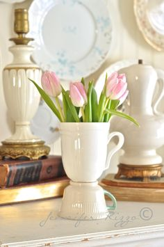 Tea cup vase made from old tea and coffee cups. Very inexpensive and its a great idea for a centerpiece at a shower or Mothers day!