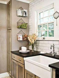 subway tile.    grey cabinets, vintage brushed brass hardware, white marble, white subway tile, white marble/concrete/porcelain farm sink, vintag brass light fixture, chalkboard paint on laundry room door