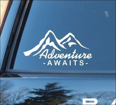 """""""Adventure Awaits""""  with Mountain silhouette Nature Calls, Outdoors, Off Road Recreation, Camping Hiking Climbing Campfire Adventure Mountain Life Mirror Mirror, Magic Mirror, Fitness, Mirror Motivation Vinyl Car Decal: measures approximately 7-1/4""""w x 3-3/4""""h (18cm x 9.5cm)  This order is f..."""